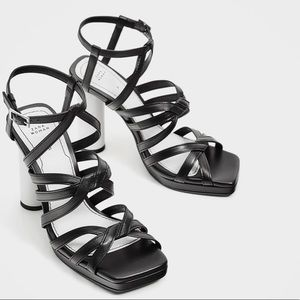 Leather sandal with contrast heel